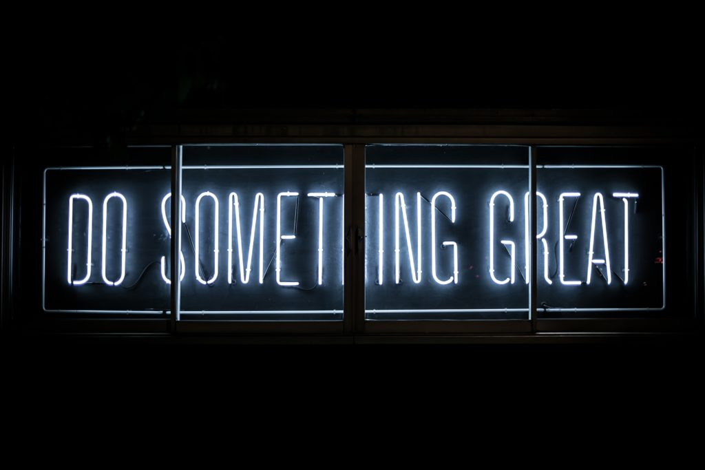 """a sign that reads """"do something great"""" winning business"""