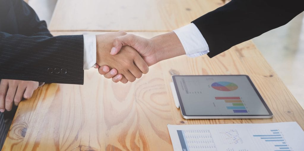 shaking hands over state government contract