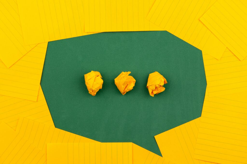 a green speech bubble on a yellow background